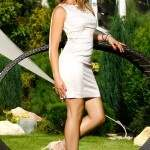 Standing in garden with white dress and heels